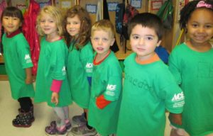Children from Park Forest Preschool in green shirts